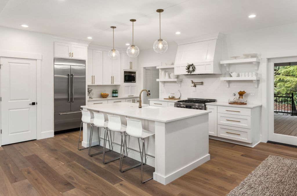 TMDC group Kitchen Remodel with white subway tiles hardwood flooring and pot filler