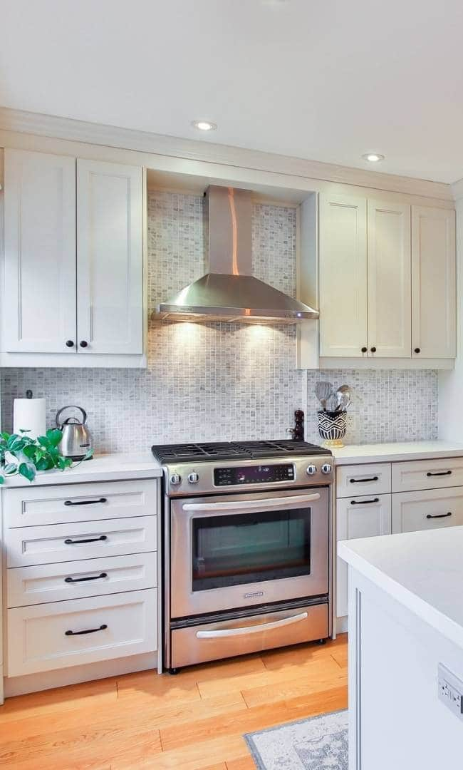Kitchen Renovation small backsplash and white modern cabinets