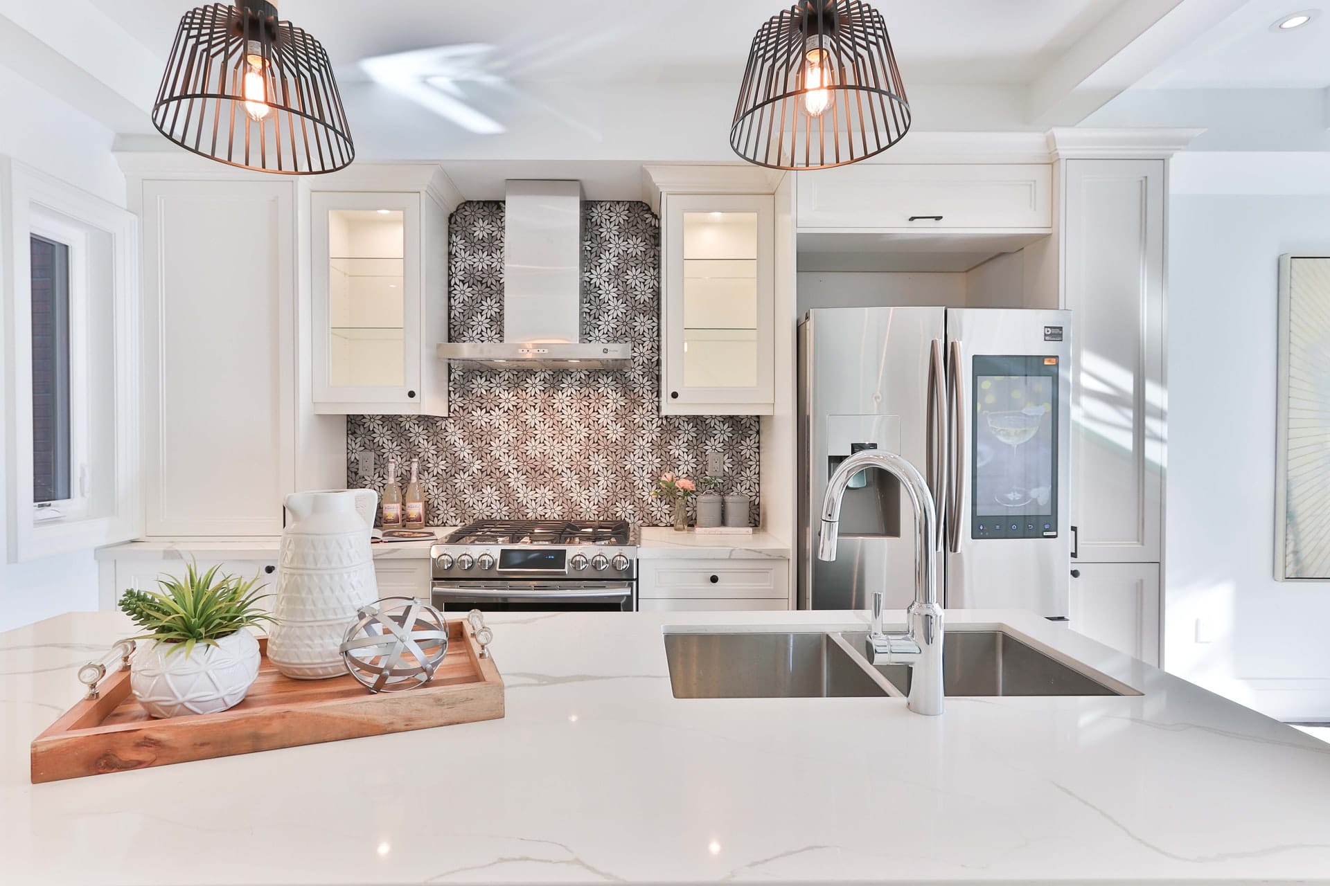 TMDC Group-Construction and Renovation - Photo of a model kitchen with floral tiles, backsplash and white marble counter top