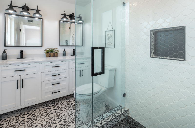 TMDC Group-Construction and Renovation - Bathroom with multiple floral and hexagone tiles stand up shower dual vanity