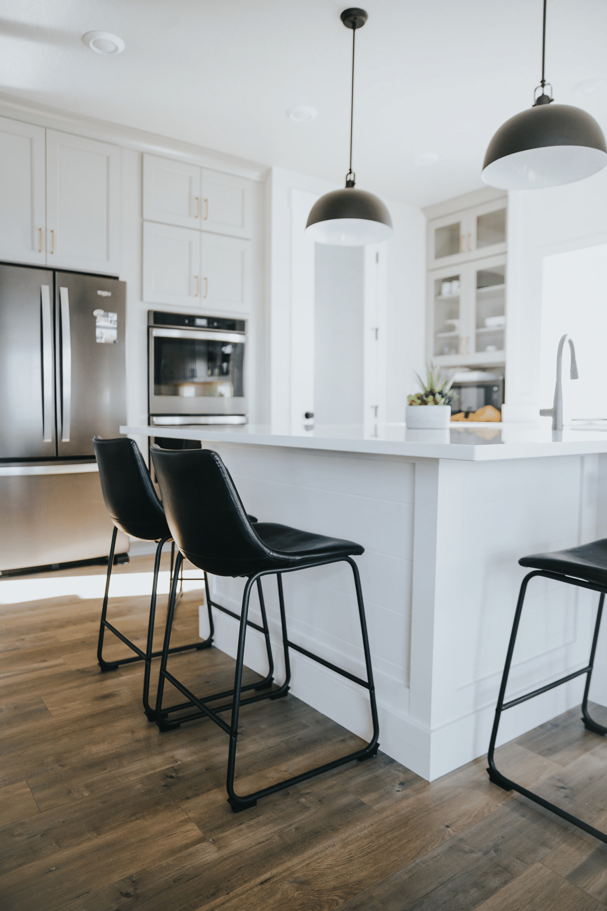 Home Renovation Company Toronto kitchen remodel white granit counter tops and pendant lighting