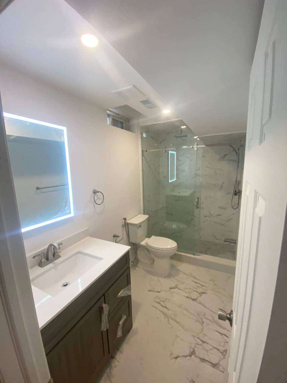 bathroom renovation with Marble tiles - Construction company in Toronto tmdc group