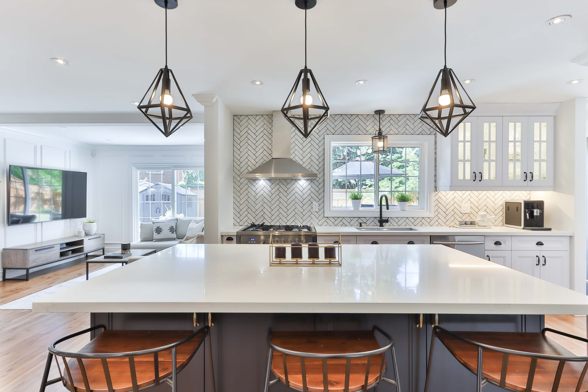 TMDC Group-Construction and Renovation - Photo of a model kitchen with herringbone tile backsplash and White granite counter top