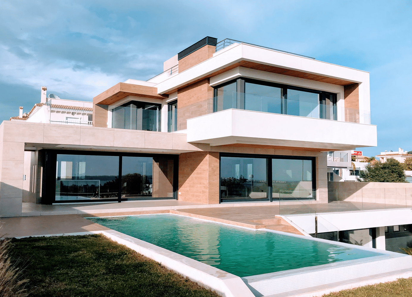 Modern exterior home with a pool